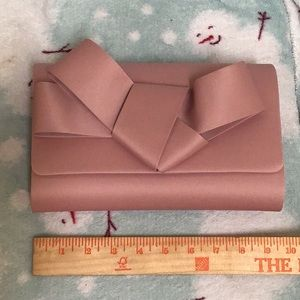 NWOT Kate Landry Rose Colored Satin Bow Clutch